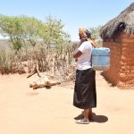The Water Project: Katung'uli Community C -  Mrs Mutula With Her Water Container