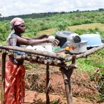 The Water Project: Mbuuni Community C -  Using Her Dish Rack
