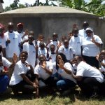 The Water Project: Imuliru Primary School -  Staff Pose With New Tank