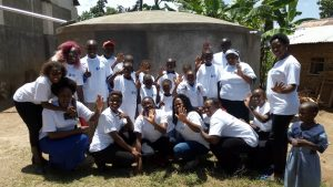 The Water Project:  Staff Pose With New Tank