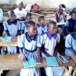 The Water Project: Imuliru Primary School -  Students Listening During Training