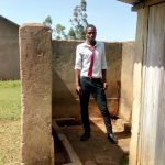 The Water Project: St. John Cheptech Secondary School -  Boy Stands In Urinal