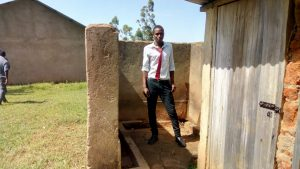 The Water Project:  Boy Stands In Urinal
