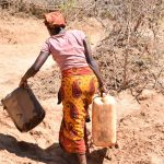The Water Project: Ngitini Community -  Carrying Containers To Collect Water
