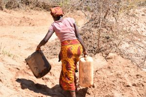 The Water Project:  Carrying Containers To Collect Water