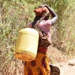 The Water Project: Ngitini Community -  Carrying Water Home