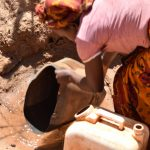 The Water Project: Ngitini Community -  Collecting Water