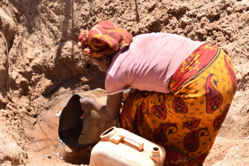 The Water Project : kenya18187-collecting-water-from-scoop-hole