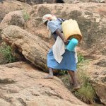 The Water Project: Ikuusya Community -  Carrying Water Home