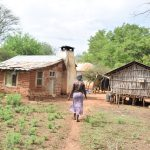 The Water Project: Ikuusya Community -  Walking Into Compound
