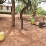 The Water Project: Ikuusya Community -  Water Storage Containers In Compound