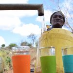 The Water Project: Katalwa Community -  Clean Water Flows From Well