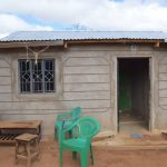 The Water Project: Katalwa Community -  Home With Water Containers Out Front