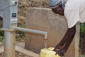 The Water Project:  Filling Water At First Well
