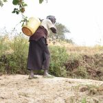 The Water Project: Ngaa Community B -  Hauling Warter Home From Source