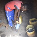 The Water Project: Masaani Community -  Taking Water In Kitchen