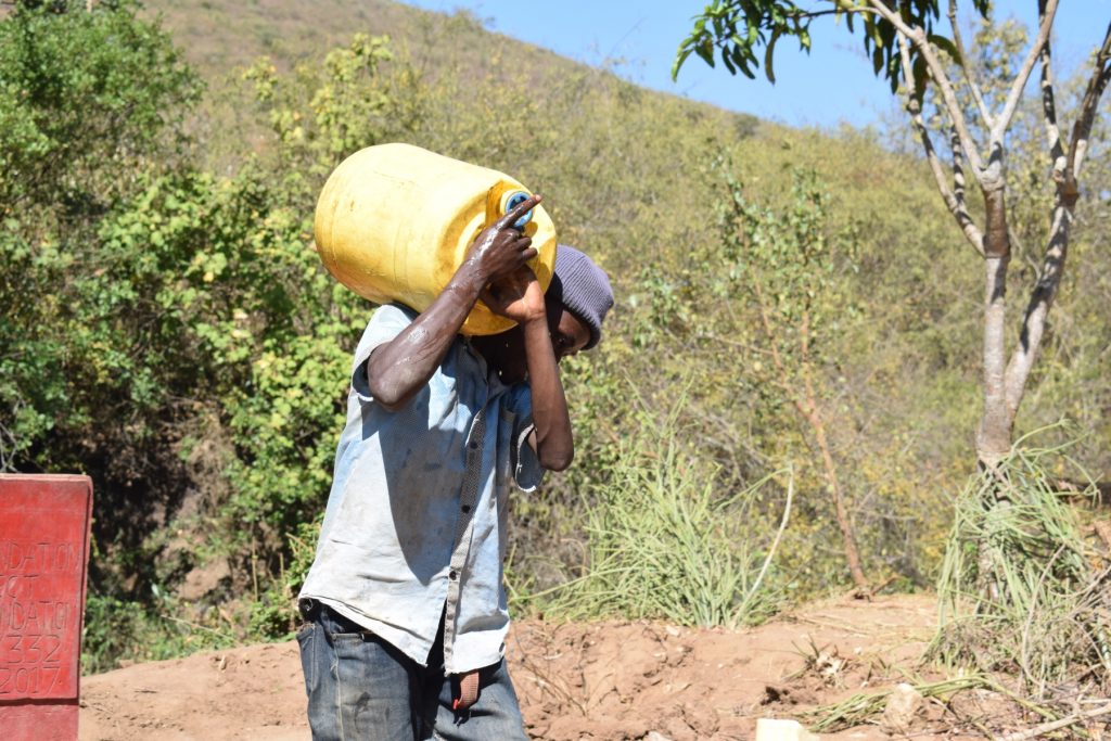 The Water Project : kenya18193-man-carrying-water