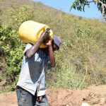 The Water Project: Ilinge Community D -  Man Carrying Water