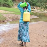 The Water Project: Kaliani Community -  Carrying Water Home