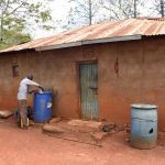 The Water Project: Kaliani Community -  Compound With Water Storage Containers