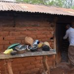 The Water Project: Kaliani Community -  Dishes In Front Of Kitchen