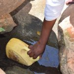 The Water Project: Mitini Community B -  Scooping Water