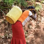 The Water Project: Utini Community -  Carrying Water