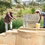 The Water Project: Kithumba Community B -  Pumping Water From Well