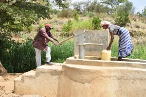 The Water Project:  Pumping Water From Well
