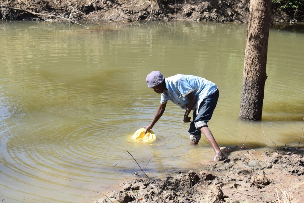 The Water Project : kenya18213-filling-jerrican-with-water