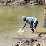The Water Project: Ilinge Community E -  Filling Jerrican With Water