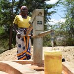 The Water Project: Kithuluni Community C -  Pumping Water From Well Constructed Last Year