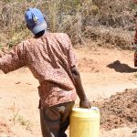 The Water Project: Ngitini Community A -  Carrying Collected Water