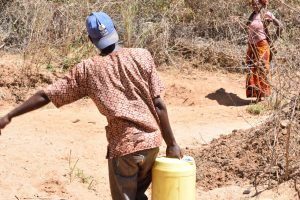 The Water Project:  Carrying Collected Water