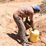 The Water Project: Ngitini Community A -  Collecting Water