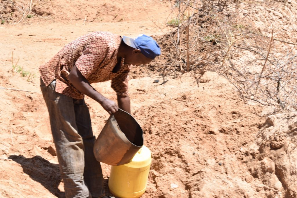The Water Project : kenya18217-pouring-water-into-jerrican