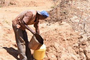 The Water Project:  Pouring Water Into Jerrican