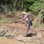 The Water Project: Kala Community A -  Hauling Water To Carry Home