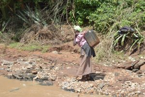 The Water Project:  Hauling Water To Carry Home