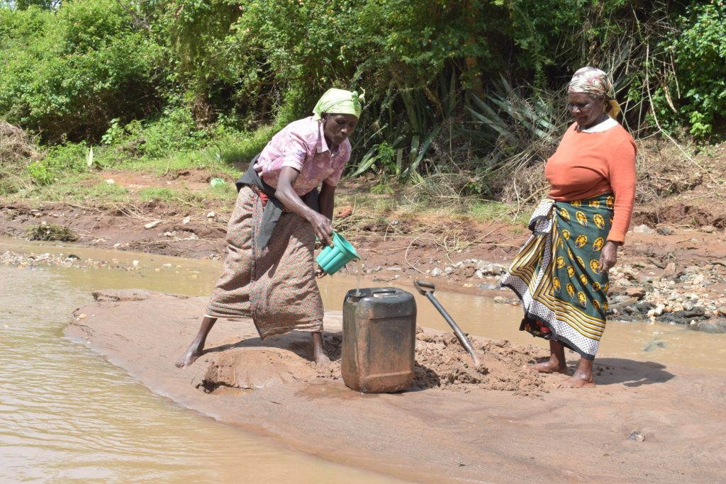 The Water Project : kenya18218-scooping-water-and-pouring-into-larger-container