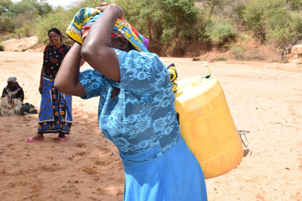 The Water Project : kenya18221-hoisting-water-to-carry-home