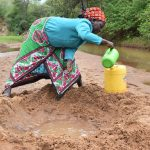 The Water Project: Kaliani Community A -  Collecting Water