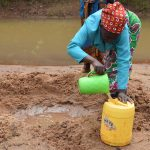 The Water Project: Kaliani Community A -  Filling Jerrican With Water