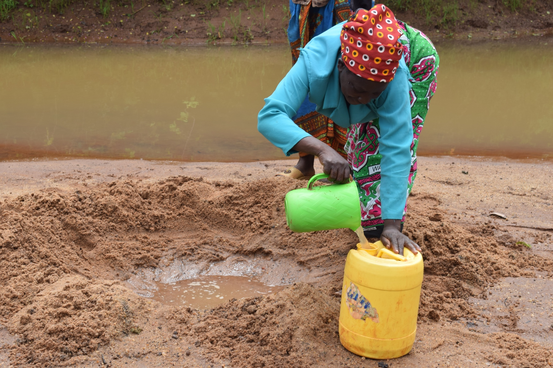 The Water Project : kenya18224-filling-jerrican-with-water
