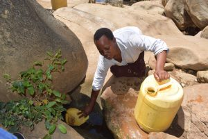 The Water Project:  Filling Jerrican With Water