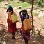 The Water Project: Utini Community A -  Carrying Water Home
