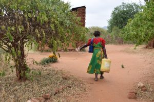 The Water Project:  Carrying Water To Kitchen