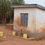 The Water Project: Ndiani Primary School -  Water Containers In Courtyard