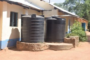 The Water Project:  Unprotected Plastic Rainwater Tanks