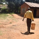 The Water Project: Kyaani Primary School -  Carrying Water